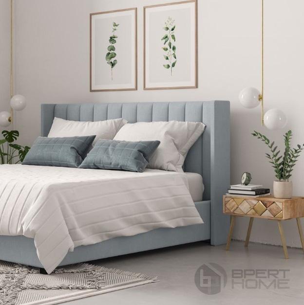 تخت خواب سفید با بالش آبی